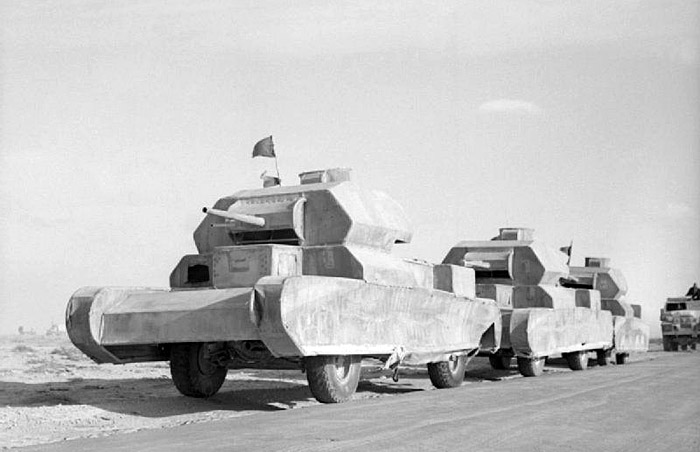 British trucks disguised as Cruiser tanks move towards the front in an attempt to fool German reconnaissance aircraft into believing an Allied offensive was imminent