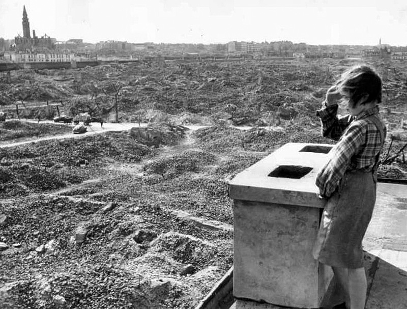 Girl looks out over the ruins of Warsaw, 1945
