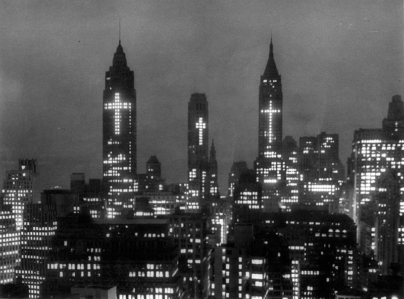 Huge crosses, formed by lighted windows blaze above New York's skyline as part of an Easter display in Manhattan's financial district, 1956
