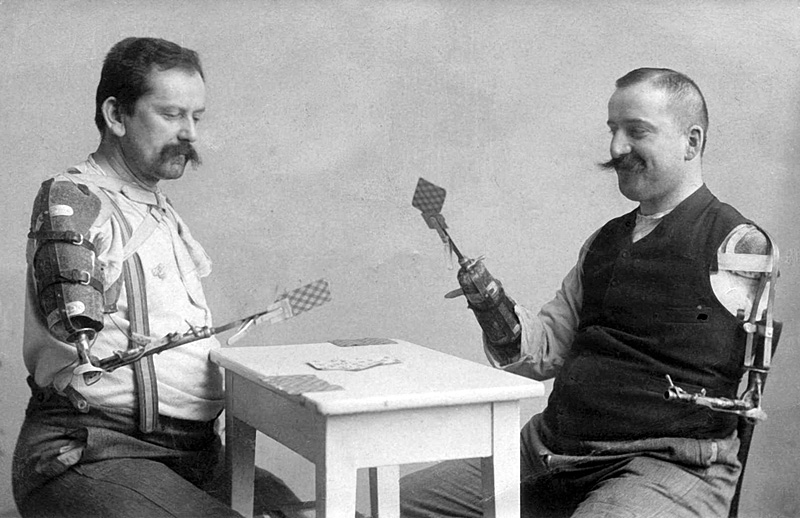 c. 1920s Men playing cards with a prosthetic arm