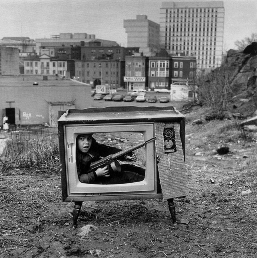 Boy hiding in a TV set. Boston, 1972 by Arthur Tress