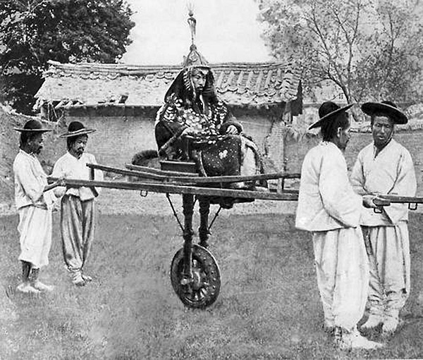 A nobleman is carried on a litter by four bearers, Korea, circa 1900
