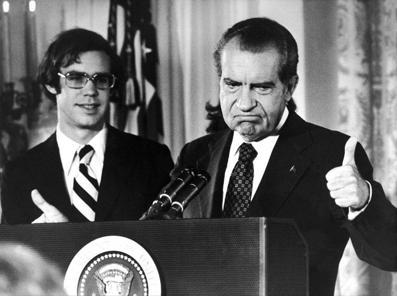 Richard Nixon gives a thumbs-up after his resignation on August 9, 1974