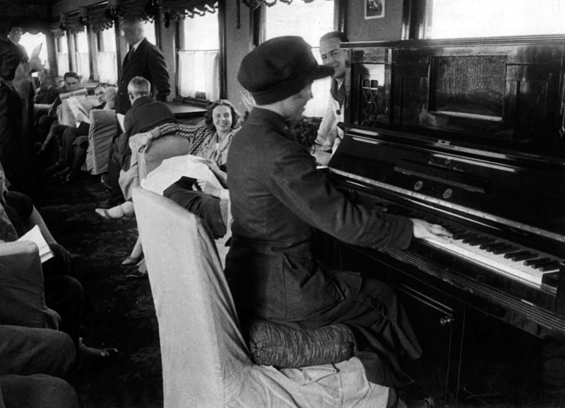 Moscow-Tbilisi express. Railroad stuff playing piano for the passangers. USSR. 1933