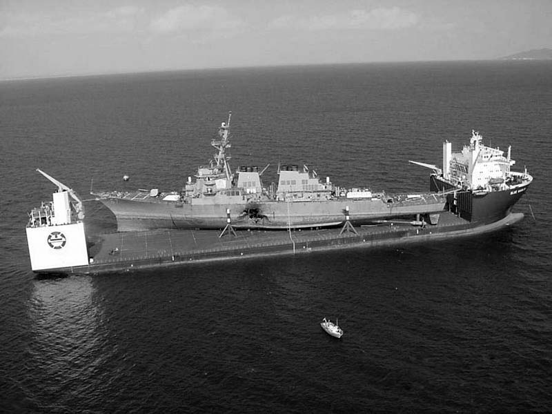 The USS Cole being carried by the MV Blue Marlin after the Al-Qaeda attack on October 12, 2000 picture taken on October 31, 2000
