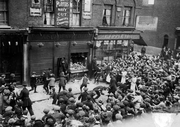 A shop owned by an individual of German origin is attacked by a mob in London's East End, 1915