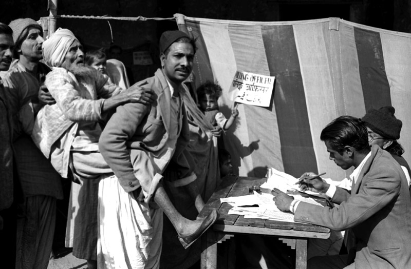 A blind voter is being carried to the polling booth in India's first General Elections - Delhi, Jan 14, 1952