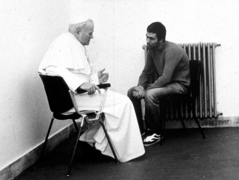 John Paul II talking with his assassin Ali Agca, 1983, in Agca's prison cell