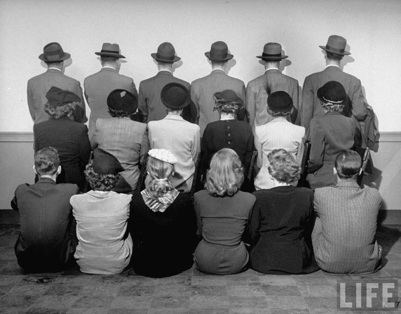 Macy's department store detectives posing for a photograph with their backs turned so as not to reveal their identity. 1948.