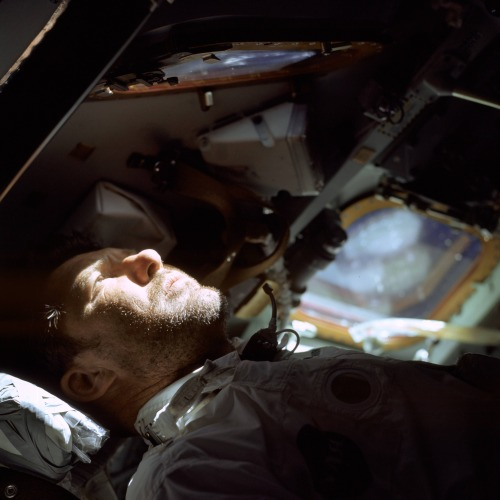 Walter Schirra looks out the window of Apollo 7's Command Module on day nine of an eleven day mission.