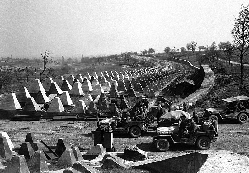 WWII --- U.S. Army soldiers at the dragon's teeth of the Siegfried Line (Germany - 1945)