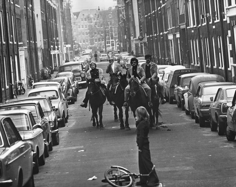 Four horsemen riding through the streets of Amsterdam on a 'motorless day', when cars are prohibited due to the oil crisis in the Middle East, 4th November 1973