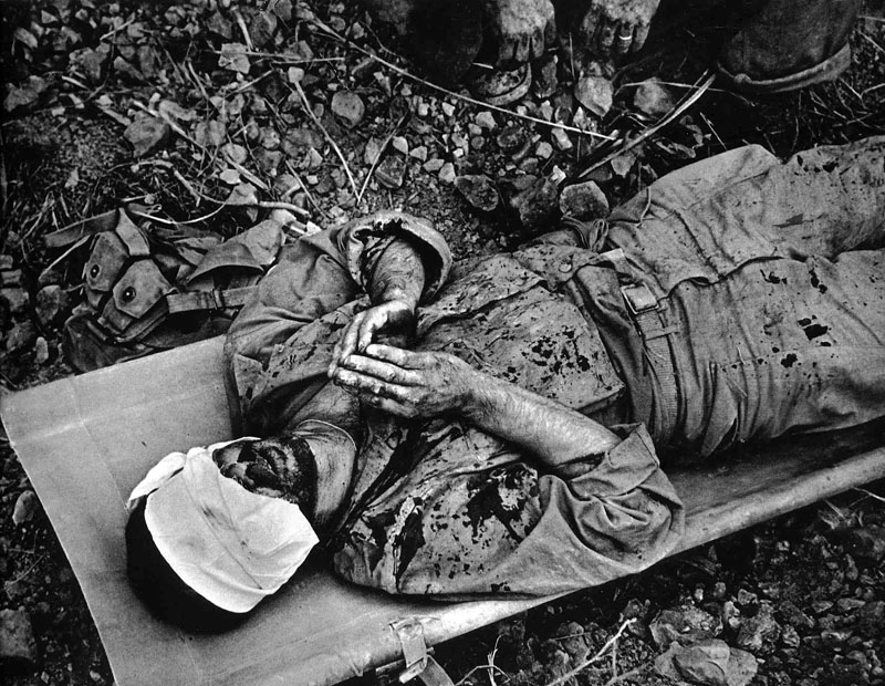 Wounded American soldier praying, Okinawa, 1945 by W. Eugene Smith