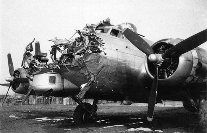 Despite heavy flak damage this B-17 returned to England after a raid over Cologne, Germany , October 1944
