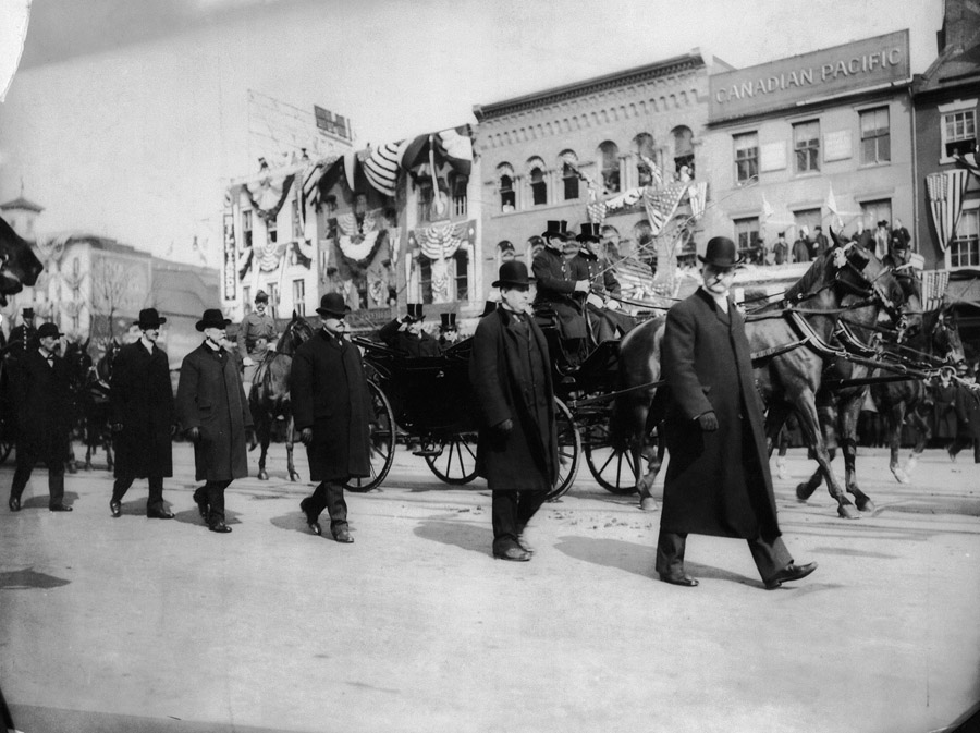 Secret Service agents walk on both sides of President Theodore Roosevelt's carriage during his inauguration on March 4, 1905. He was the first President to be provided Secret Service Protection