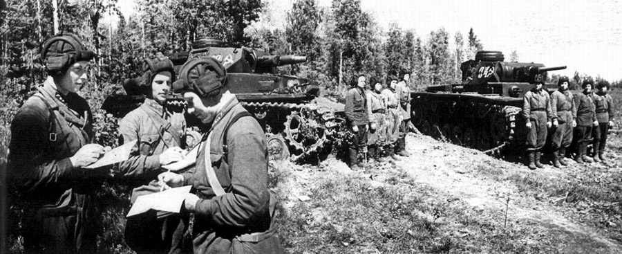 WWII --- Russian soldiers with captured German tanks (Panzer IV and Panzer III)
