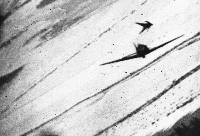 January 27, 1945, a German pilot was captured on film after hastily exiting his damaged plane, hurtling through the air, legs outstretched, high above the frigid landscape of Belgium.