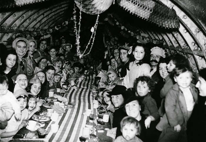 London, children enjoy themselves at a Christmas Party, in an underground shelter (1940)
