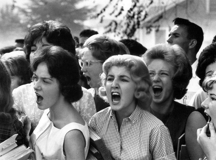 White high school students cursing black students on the first day that public schools were integrated in Montgomery, Alabama, 1963