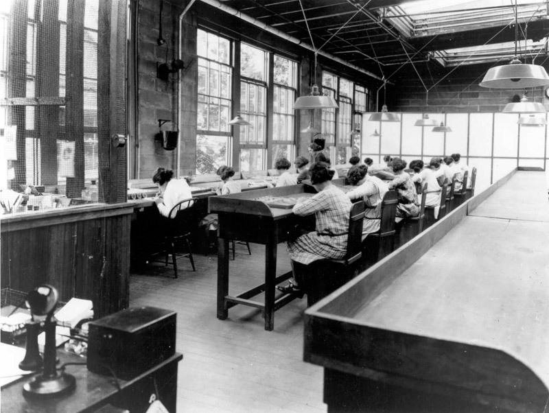 Radium Girls painting watch dials with radioactive glow-in-the-dark paint on January 1, 1922. Many of them had to die from cancer because of unsafe working conditions.