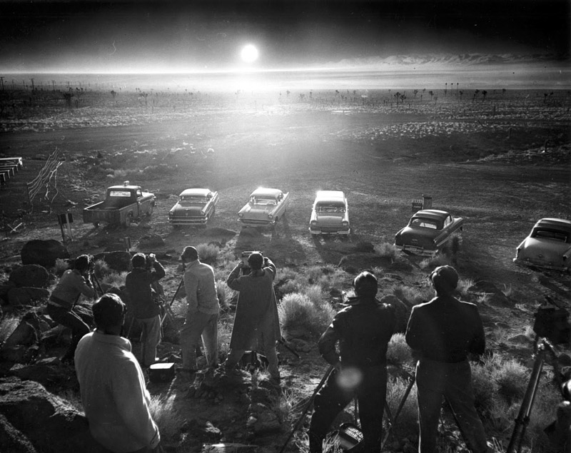 Photographers and reporters gather near Frenchman Flat to observe the Priscilla nuclear test (1957)