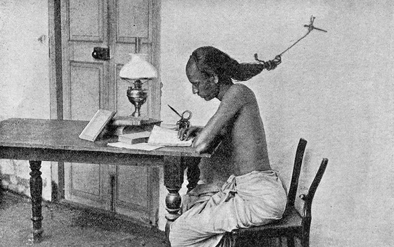 Student of University of Madras. Preparations for exams. Working hard, they tie hair to nail in wall to prevent falling into sleep. 1900s