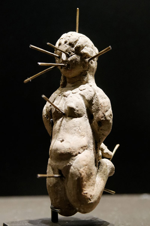 Graeco-Roman curse effigy (�voodoo doll�), pierced by 13 needles. Egypt, 2nd cent CE