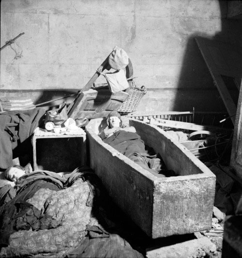 A man sleeps ina  ston sarcophagus in an East London church during the Blitz:November 1940