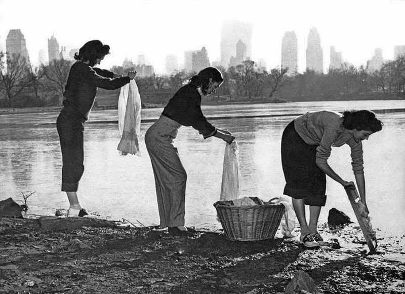 Three young women wash their clothes in Central Park during a water shortage, New York, 1949