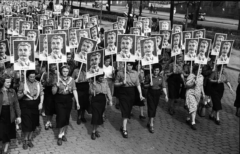 Women march with Stalin's picture at the Third World Festival of Youth and Students in East Berlin