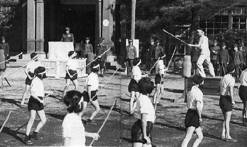 WWII --- Japanese high school girls training with bamboo spears in preparation for a U.S. invasion 1944
