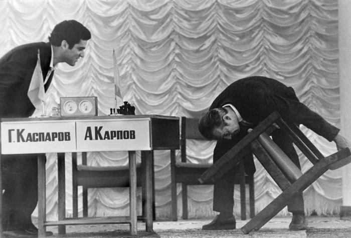 A judge checks player's chairs in the Karpov v Kasparov world chess championship match in 1984.
