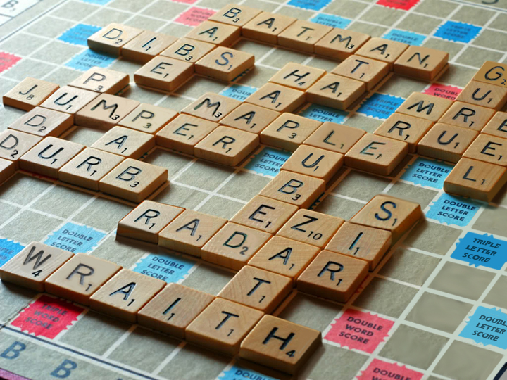 Scrabble game on board with Mcshep type of words.
