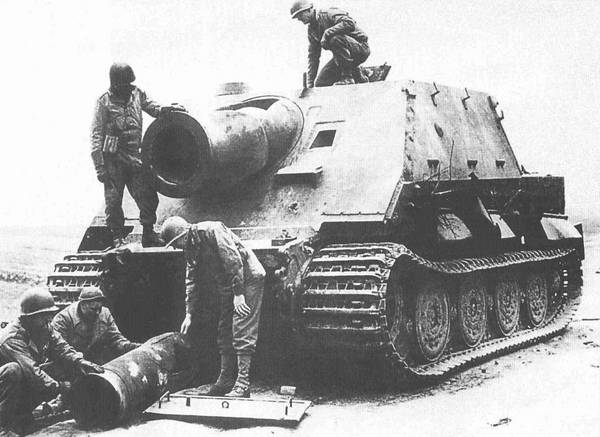 Sturmtiger_abandoned_and_blown_by_its_crew_and_captured_by_US_troops