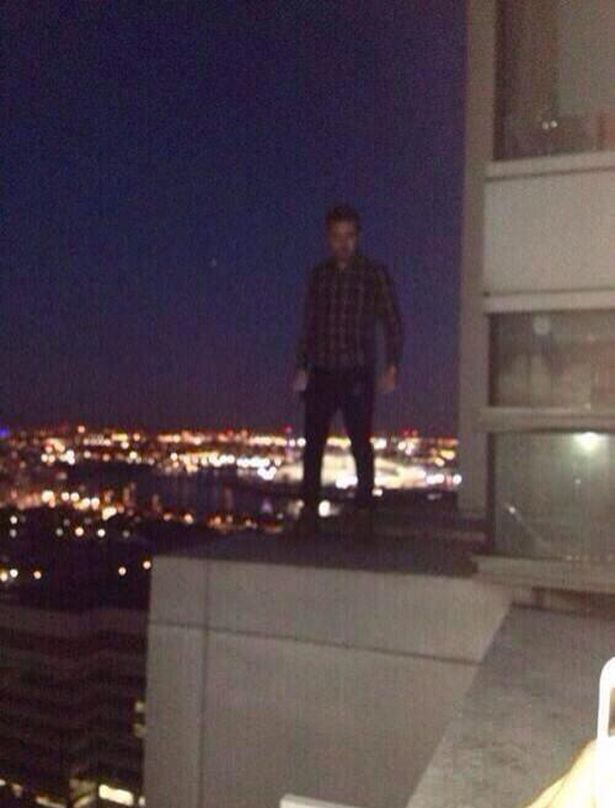 Liam-Payne-poses-on-sky-high-balcony-in-reckless-photo-3021429