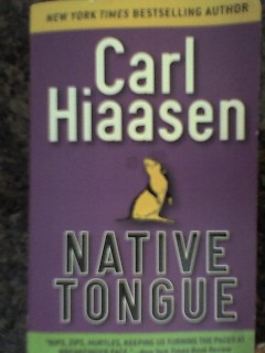 The paperback cover of Native Tongue, by Carl Hiaasen