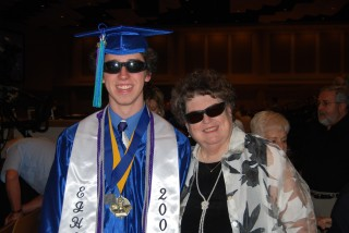 Critter, in cap and gown and all,  and Mom, both in sunglasses