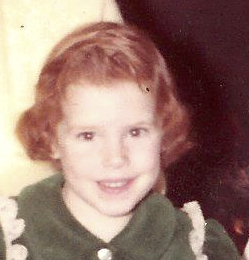 A picture of me as a young child, showing my still very bright red hair.