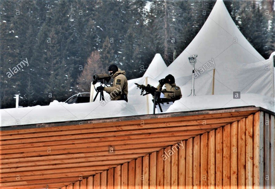 swiss-army-snipers-on-the-lookout-from-the-rooftop-of-the-heavily-KY358F