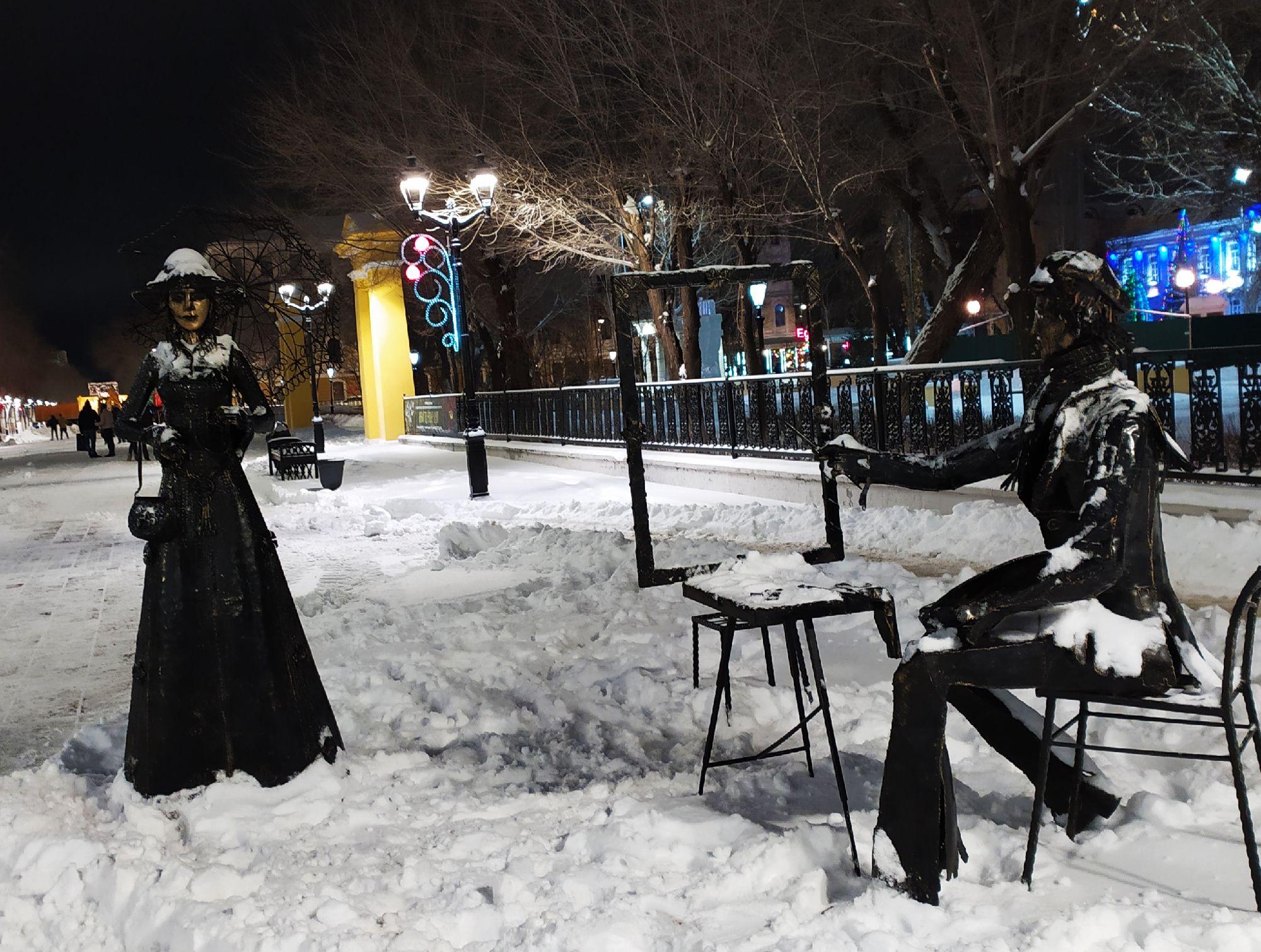 Художник и дама с зонтиком.