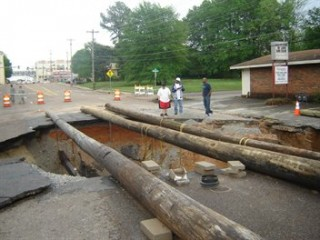 Sink hole caused by flooding in Jackson, TN