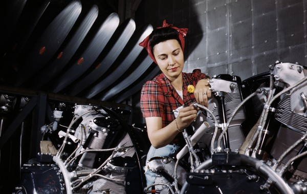 Woman_working_on_an_airplane_motor_at_North_American_Aviation,_Inc.,_plant_in_Calif (1).jpg