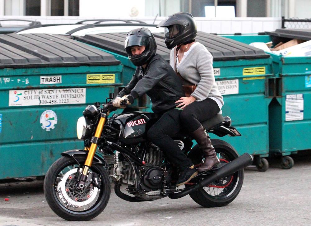 Orlando & Miranda's Mum on a motorcycle