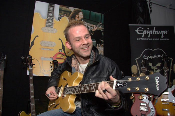 Dom with guitar at event