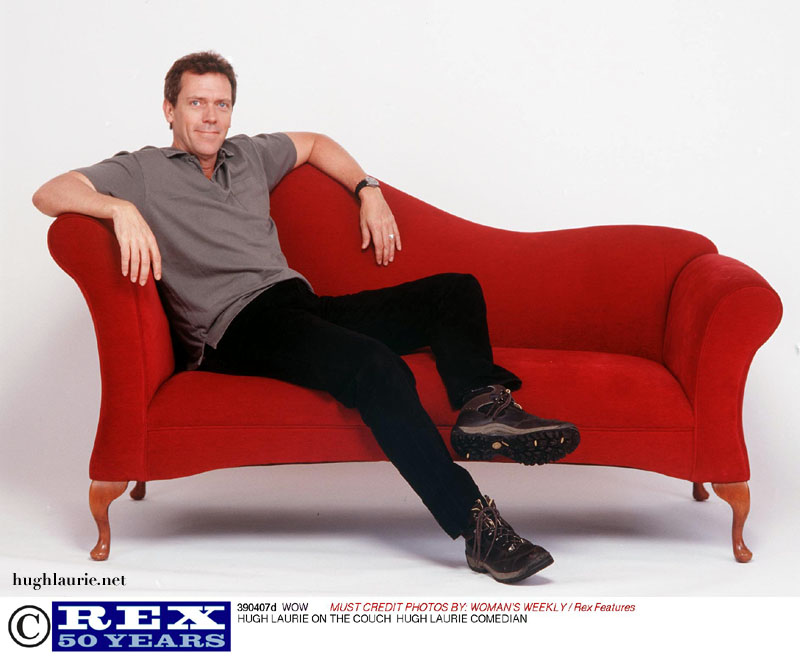 Hugh on red couch
