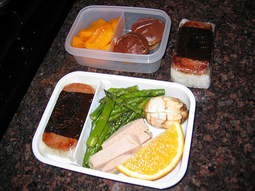 [bento with tea marbled eggs, spam musubi, and other good stuff]