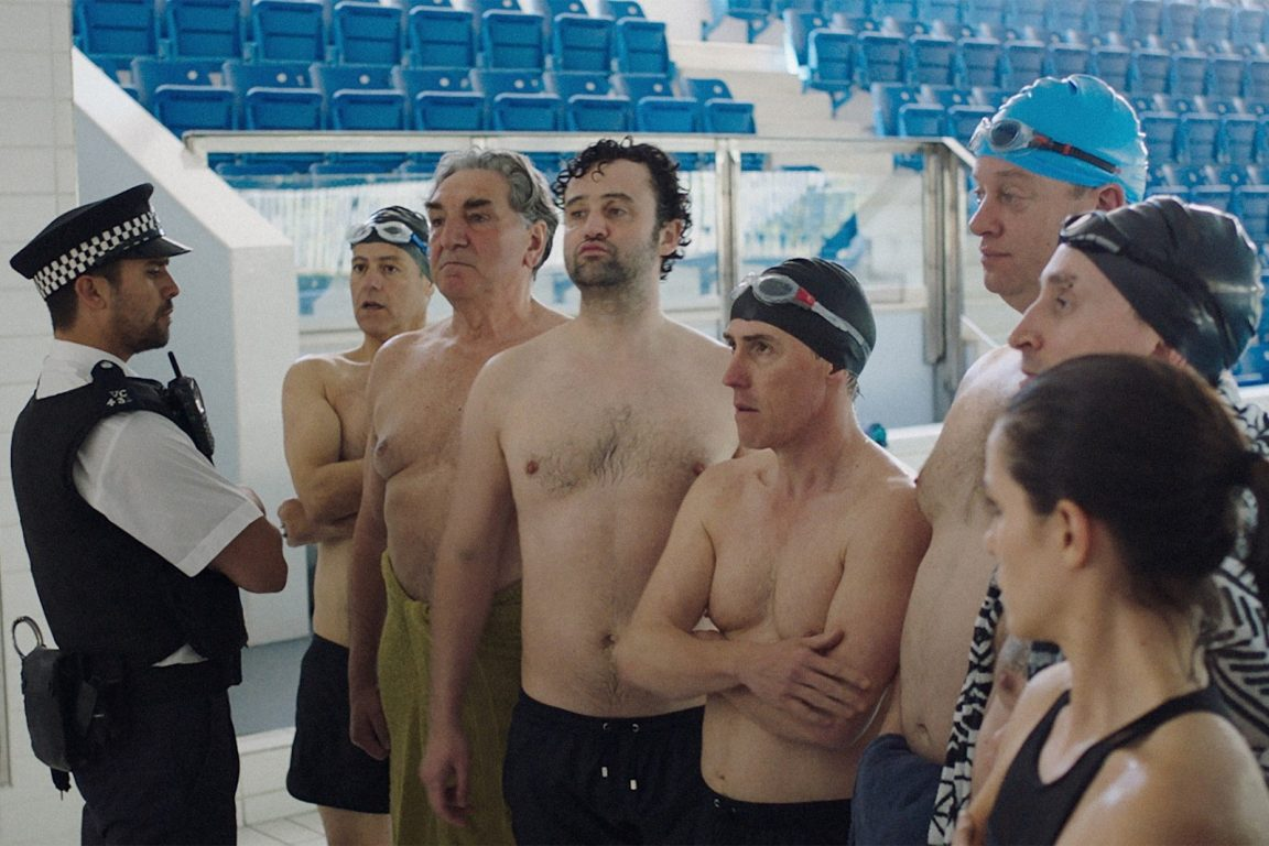 sfondo-swimming-with-men-1152x768