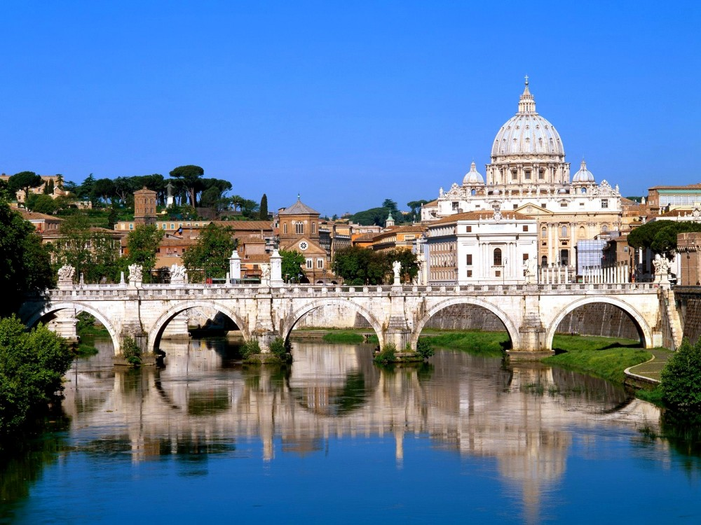 the_vatican_seen_past_the_tiber_river_rome_italy