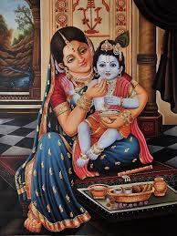 Mother feeding a child
