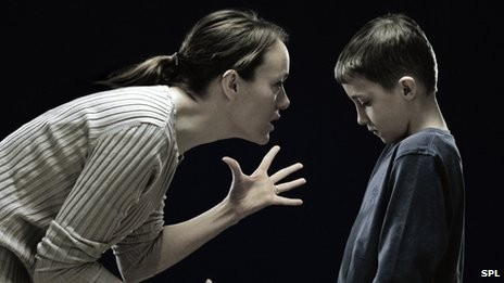 63447887_mother_telling_off_son